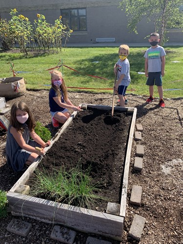 Sugar Creek students engaging in the outdoor garden.