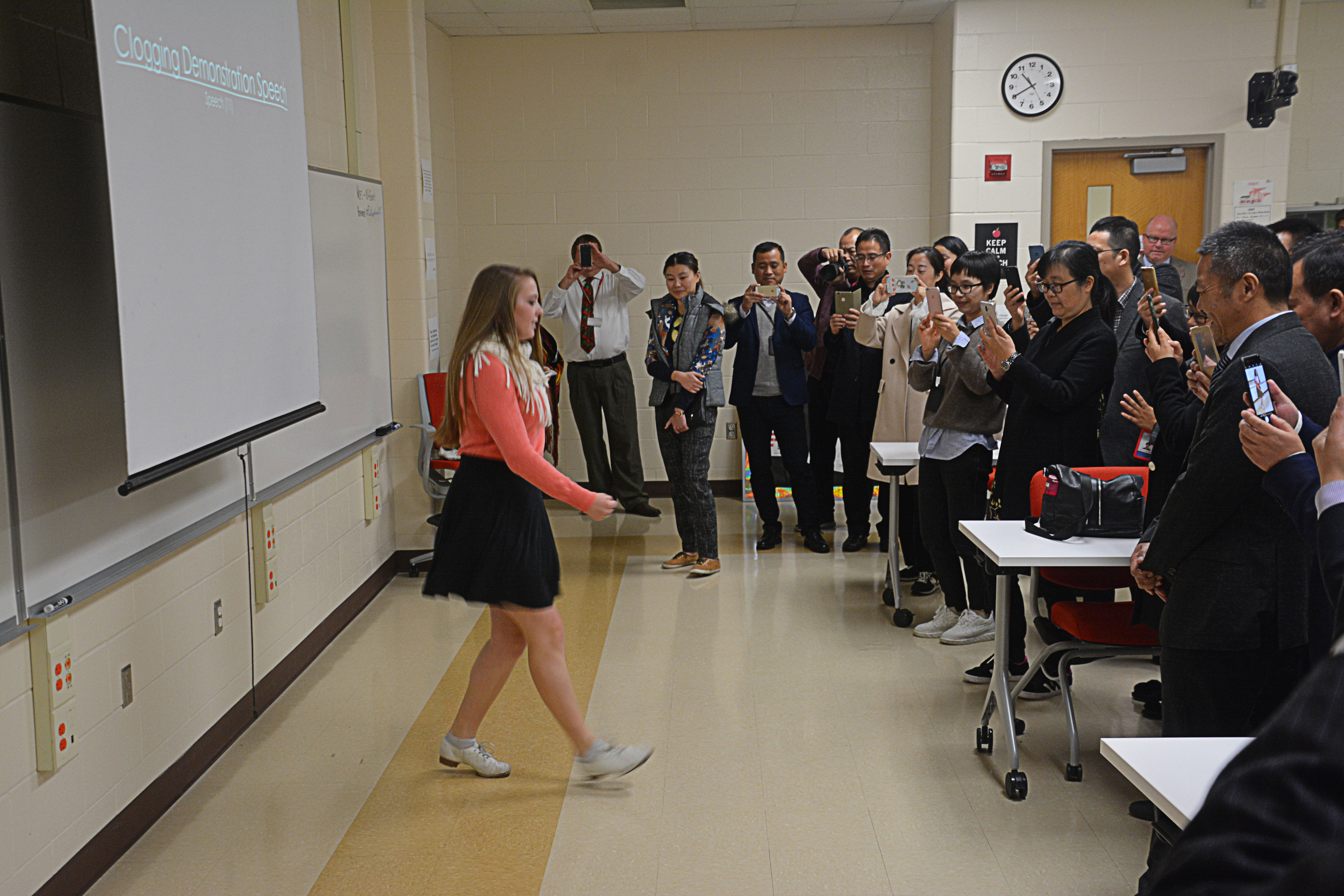 NPHS Senior Ellie Roudebush teaching administrators from China how to clog dance.